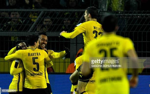 Dortmund's Gabonese forward PierreEmerick Aubameyang celebrates scoring the 10 goal during the German First division Bundesliga football match...