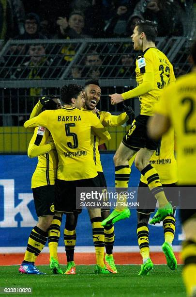 Dortmund's Gabonese forward PierreEmerick Aubameyang celebrates scoring the 10 goal with his teammates during the German First division Bundesliga...