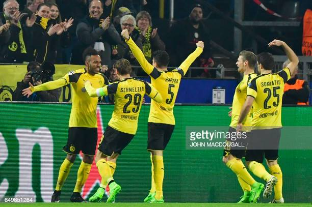 Dortmund's Gabonese forward PierreEmerick Aubameyang celebrates scoring the opening goal with his teammates during the UEFA Champions League Round of...
