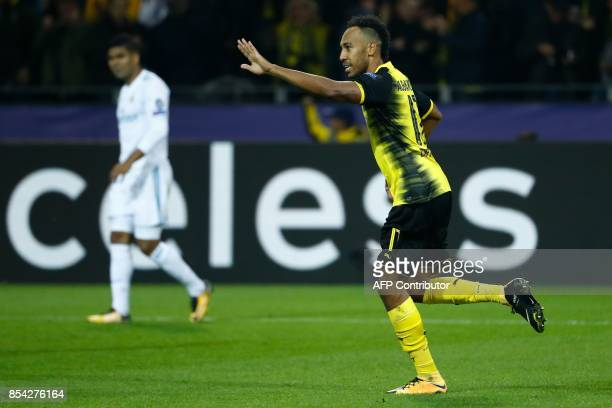 Dortmund's Gabonese forward Pierre-Emerick Aubameyang celebrates scoring during the UEFA Champions League Group H football match BVB Borussia...