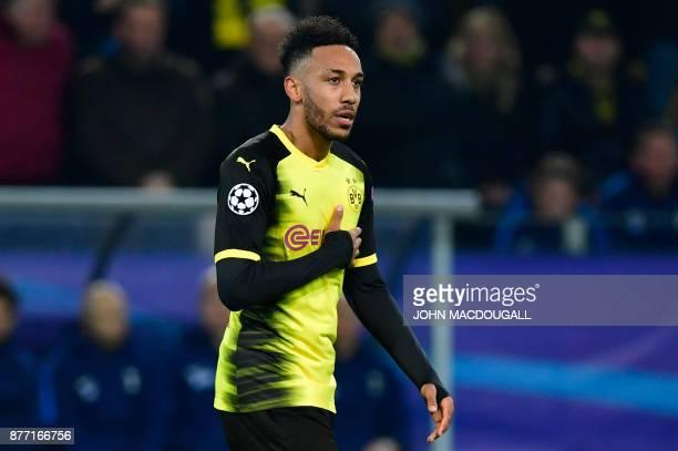 Dortmund's Gabonese forward PierreEmerick Aubameyang celebrates scoring the opening goal during the UEFA Champions League Group H football match BVB...