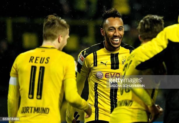Dortmund's Gabonese forward PierreEmerick Aubameyang celebrates with his teammates after the German First division Bundesliga football match between...