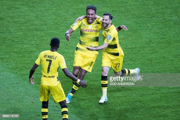 Dortmund's Gabonese forward PierreEmerick Aubameyang celebrates with Dortmund's midfielder Gonzalo Castro and Dortmund's French midfielder Ousmane...
