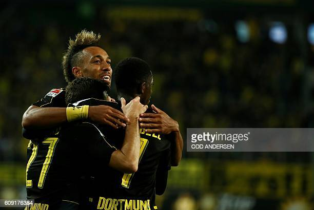 Dortmund's Gabonese forward PierreEmerick Aubameyang Dortmund's French midfielder Ousmane Dembele and Dortmund's midfielder Gonzalo Castro celebrate...
