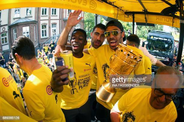 Dortmund's Gabonese forward PierreEmerick Aubameyang Dortmund's Greek defender Sokratis and Dortmund's French midfielder Ousmane Dembele pose with...