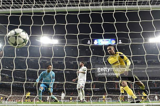 Dortmund's Gabonese forward PierreEmerick Aubameyang eyes the ball after scoring a goal during the UEFA Champions League football match Real Madrid...
