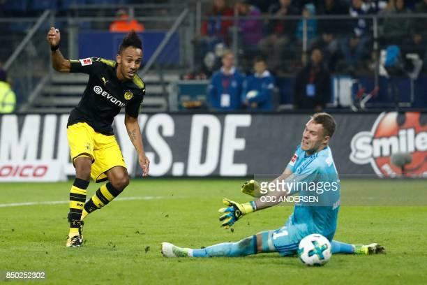 Dortmund's Gabonese forward PierreEmerick Aubameyang fails to score past Hamburg's German goalkeeper Christian Mathenia during the German first...