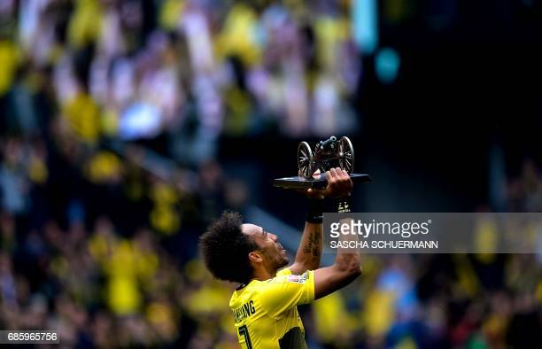 Dortmund's Gabonese forward PierreEmerick Aubameyang lifts the trophy for Bundesliga top scorer after the German first division football match...
