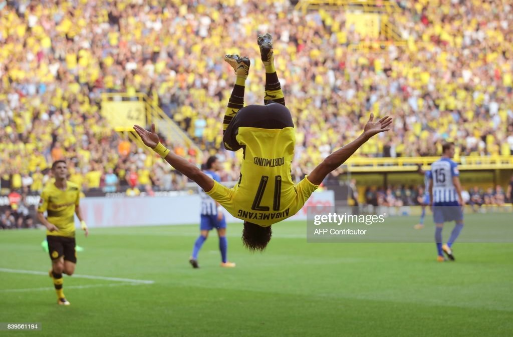 Dortmund's Gabonese forward Pierre-Emerick Aubameyang makes a somersault after scoring the first goal during the German First division Bundesliga football match between Borussia Dortmund and Hertha Berlin in Dortmund, western Germany, on August 26, 2017. /