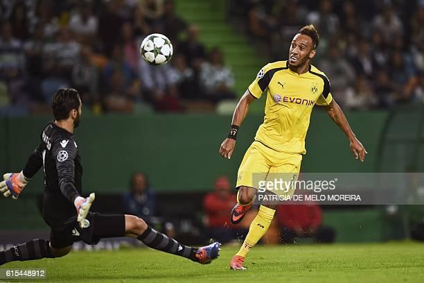 Dortmund's Gabonese forward PierreEmerick Aubameyang scores a goal during the UEFA Champions League football match Sporting CP vs BVB Borussia...