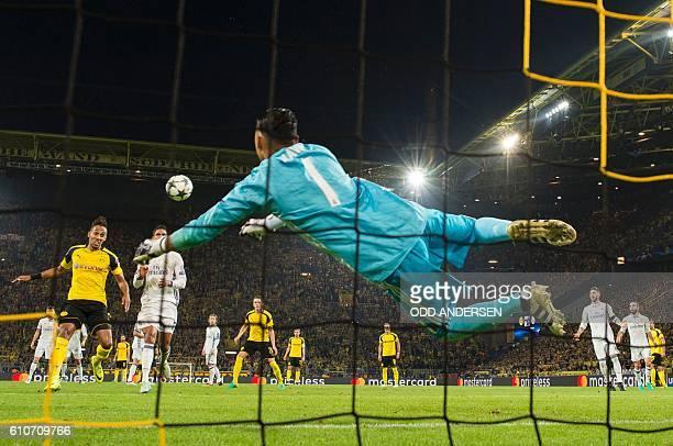 Dortmund's Gabonese forward PierreEmerick Aubameyang scores past Real Madrid's Costa Rican goalkeeper Keylor Navas during the UEFA Champions League...