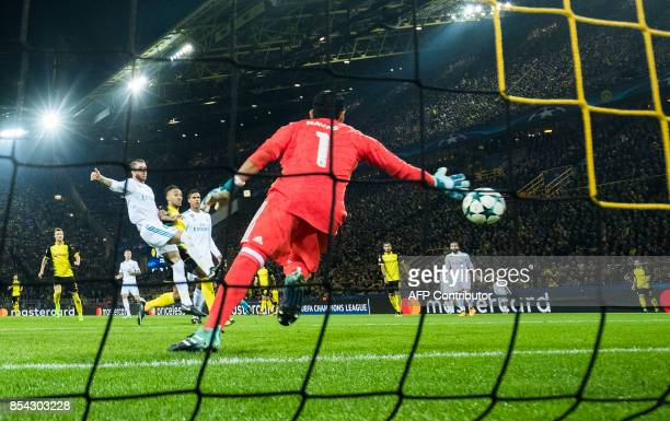 Dortmund's Gabonese forward Pierre-Emerick Aubameyang scores past Real Madrid's goalkeeper from Costa Rica Keylor Navas during the UEFA Champions...