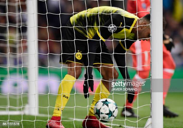 Dortmund's Gabonese forward PierreEmerick Aubameyang takes the ball after scoring a goal during the UEFA Champions League group H football match Real...