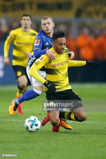 Dortmund's Gabonese forward PierreEmerick Aubameyang vies for the ball during the German First division Bundesliga football match between Borussia...