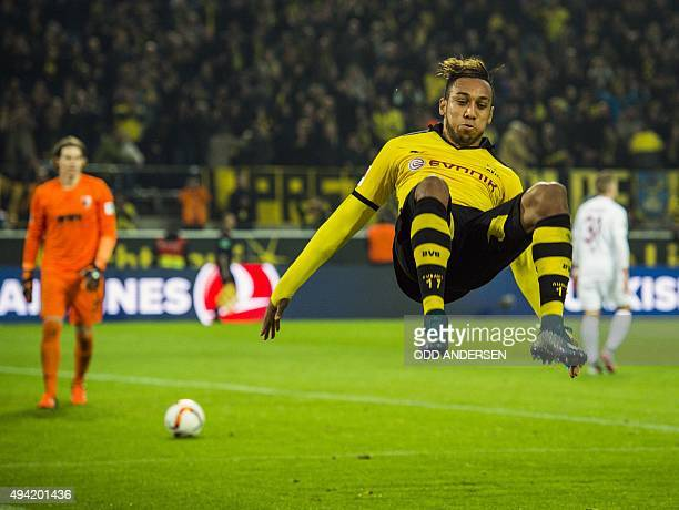 Dortmund's Gabonese midfielder PierreEmerick Aubameyang somersaults as he celebrates scoring his side's 5th goal to complete his hattrick during the...