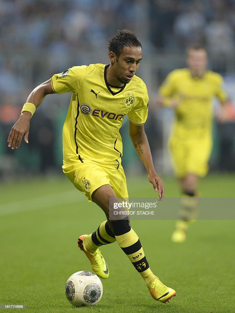 Dortmund's Gabonese Pierre-Emerick Aubameyang plays the ball during the second round football match of the German Cup (DFB - Pokal) TSV 1860 Munich vs Borussia Dortmund on September 24, 2013 in Munich, southern Germany. STACHE