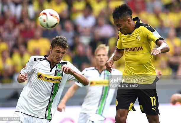 Dortmund's Gabonese striker PierreEmerick Aubameyang and Moenchengladbach's Danish defender Andreas Christensen vie for the ball during the German...