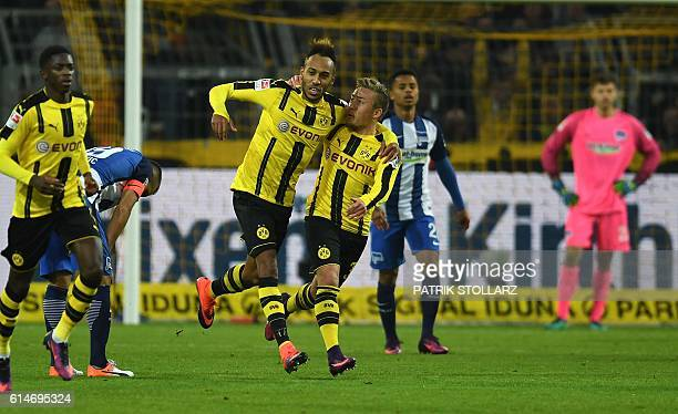 Dortmund's Gabonese striker PierreEmerick Aubameyang and Dortmund's defender Felix Passlack celebrate after a goal during the German first division...
