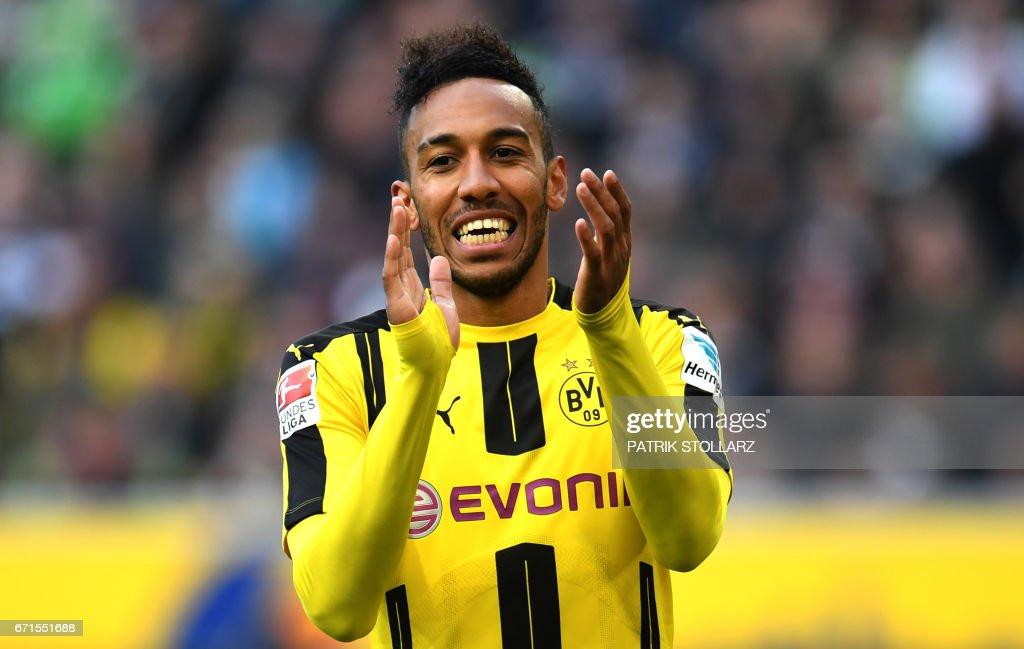Dortmund's Gabonese striker Pierre-Emerick Aubameyang celebrate after scoring during the German first division Bundesliga football match Borussia Moenchengladbach v BVB Borussia Dortmund in Moenchengladbach, western Germany, on April 22, 2017. /
