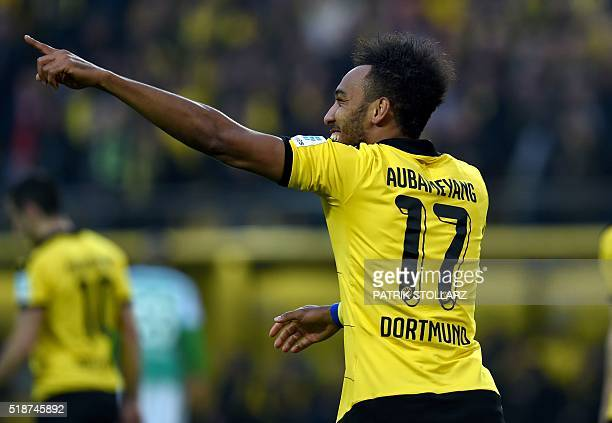 Dortmund's Gabonese striker PierreEmerick Aubameyang celebrates after scoring during the German Bundesliga first division football match between...