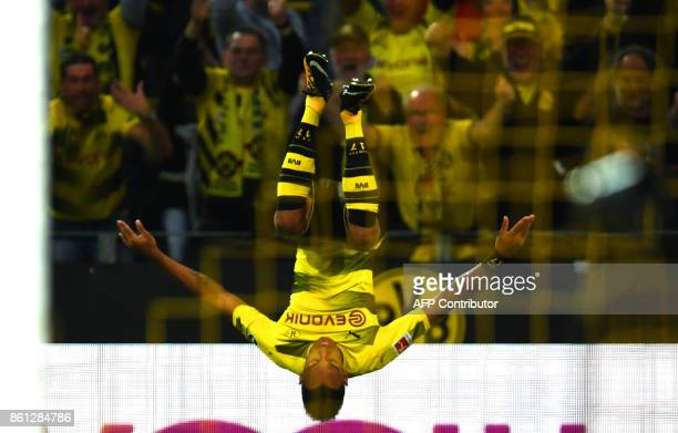 Dortmund's Gabonese striker PierreEmerick Aubameyang celebrates after scoring 10 during the German first division Bundesliga football match Borussia...