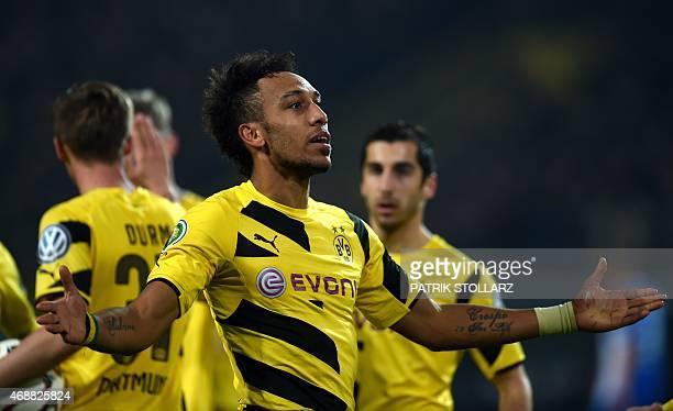 Dortmund's Gabonese striker PierreEmerick Aubameyang celebrates during the German Football Cup DFB Pokal quarterfinal match between Borussia Dortmund...
