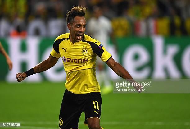 Dortmund's Gabonese striker PierreEmerick Aubameyang celebrates during the UEFA Champions League first leg football match between Borussia Dortmund...