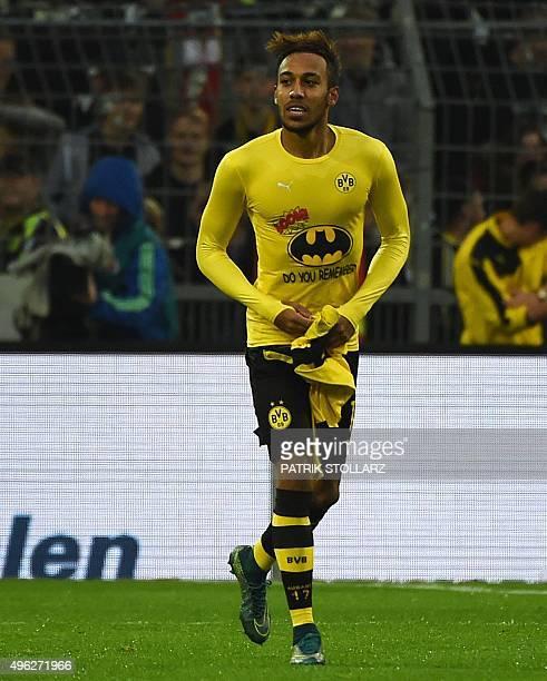 Dortmund's Gabonese striker PierreEmerick Aubameyang celebrates scoring showing his Batman shirt during the German first division football Bundesliga...
