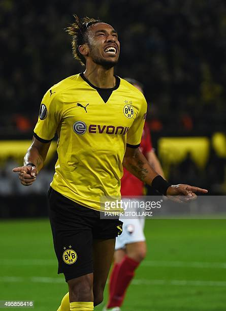 Dortmund's Gabonese striker PierreEmerick Aubameyang celebrates scoring during the UEFA Europa League football match Borussia Dortmund vs Qabala FK...