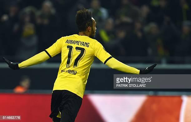 Dortmund's Gabonese striker PierreEmerick Aubameyang celebrates scoring during the UEFA Europe League Round of 16 first leg football match between...