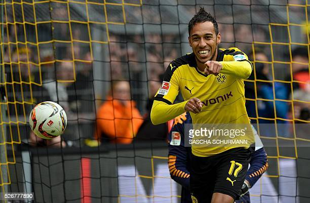 Dortmund's Gabonese striker PierreEmerick Aubameyang celebrates scoring the 40 goal during the German first division Bundesliga football match...