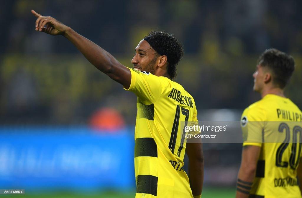 Dortmund's Gabonese striker Pierre-Emerick Aubameyang celebrates scoring during the German First division Bundesliga football match Borussia Dortmund vs Borussia Moenchengladbach in Dortmund, western Germany, on September 23, 2017. /
