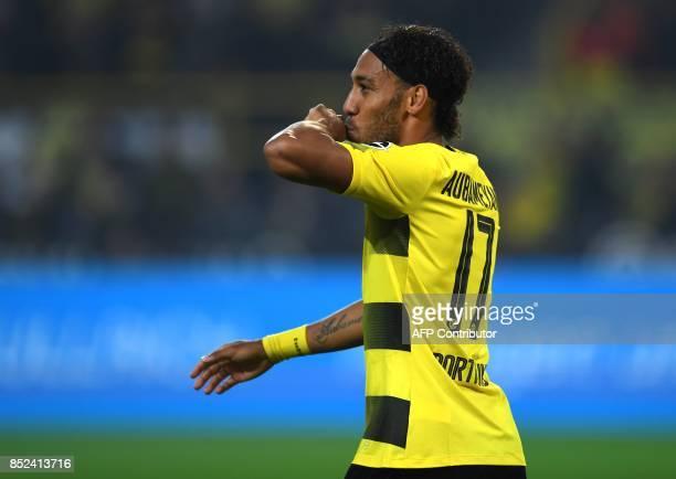 Dortmund's Gabonese striker PierreEmerick Aubameyang celebrates scoring during the German First division Bundesliga football match Borussia Dortmund...