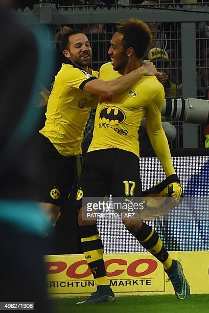 Dortmund's Gabonese striker PierreEmerick Aubameyang celebrates scoring with his teammate midfielder Gonzalo Castro showing his Batman shirt during...