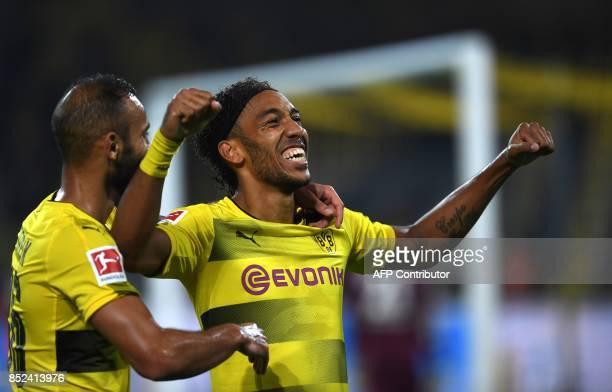 Dortmund's Gabonese striker PierreEmerick Aubameyang celebrates scoring with Turkish defender Omer Toprak during the German First division Bundesliga...