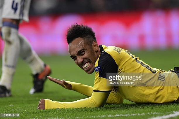 Dortmund's Gabonese striker PierreEmerick Aubameyang gestures after missing a goal during the UEFA Champions League football match Real Madrid CF vs...