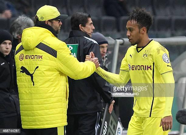 Dortmund's Gabonese striker PierreEmerick Aubameyang is congratulated by Dortmund's headcoach Juergen klopp after the German Cup quarter final...