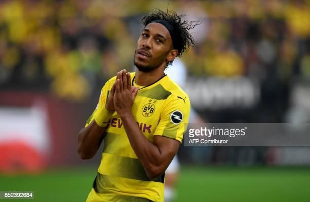 Dortmund's Gabonese striker PierreEmerick Aubameyang reacts during the German First division Bundesliga football match Borussia Dortmund vs Borussia...
