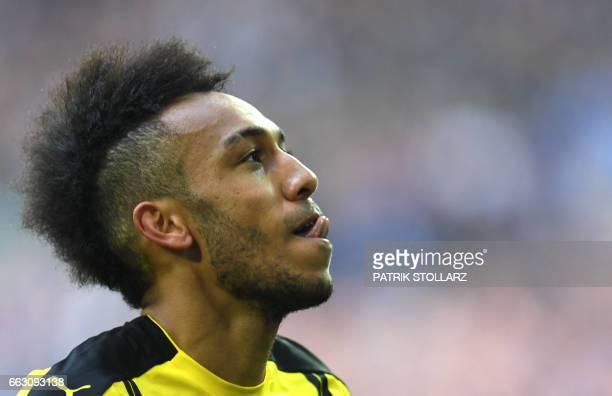Dortmund's Gabonese striker PierreEmerick Aubameyang reacts duringthe German first division Bundesliga football match between FC Schalke 04 and...