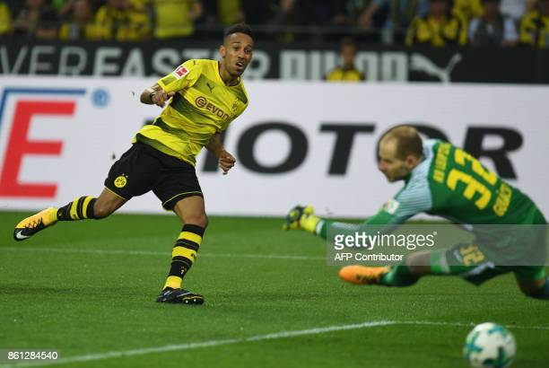 Dortmund's Gabonese striker PierreEmerick Aubameyang scores 10 during the German first division Bundesliga football match Borussia Dortmund vs RB...