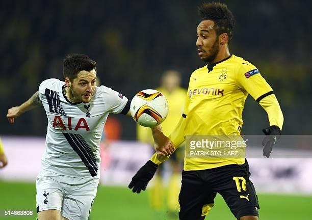 Dortmund's Gabonese striker PierreEmerick Aubameyang vies with Tottenham´s Ryan Mason during the UEFA Europe League Round of 16 first leg football...