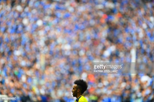 TOPSHOT Dortmund's Gabonese striker PierreEmerick Aubameyang warms up prior to the German first division Bundesliga football match between FC Schalke...
