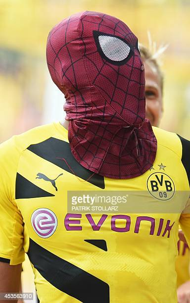 Dortmund's Gabonese striker PierreEmerick Aubameyang who put on a Spiderman mask celebrates scoring the 20 goal during the German Supercup football...