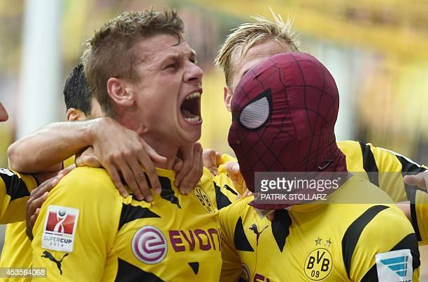 Dortmund's Gabonese striker PierreEmerick Aubameyang who put on a Spiderman mask celebrates scoring the 20 goal with Dortmund's Polish defender...