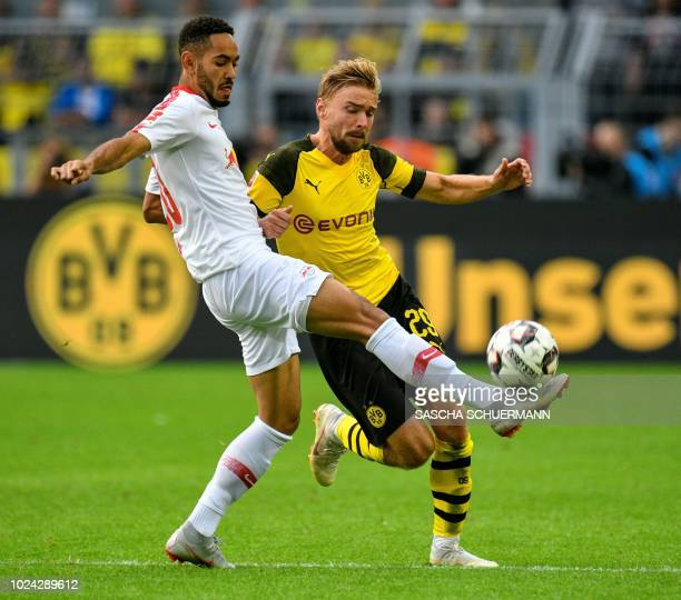 Dortmund's German defender Marcel Schmelzer and Leipzig's Brazilian forward Matheus Cunha vie for the ball during the German first division...