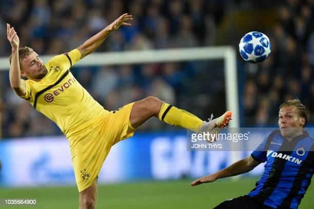 Dortmund's German defender Marcel Schmelzer vies with Club Brugge's Dutch midfielder Ruud Vormer during the UEFA Champions League Group C football...