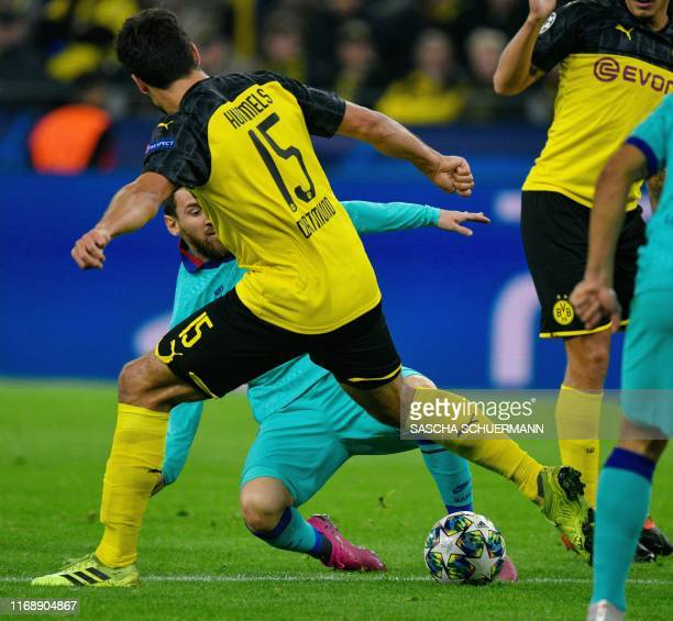 Dortmund's German defender Mats Hummels and Barcelona's Argentine forward Lionel Messi vie for the ball during the UEFA Champions League Group F...