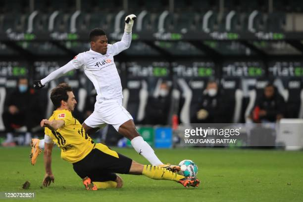 Dortmund's German defender Mats Hummels and Moenchengladbach's Swiss forward Breel Embolo vie for the ball during the German first division...