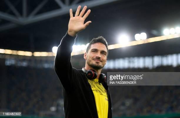 Dortmund's German defender Mats Hummels waves to fans prior to the first round match between KFC Uerdingen 05 and BVB Borussia Dortmund in...