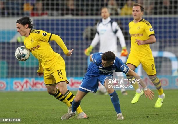 Dortmund's German defender Nico Schulz and Hoffenheim's Austraian midfielder Christoph Baumgartner vie for the ball during the German First division...